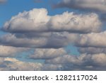 view on rain clouds in a sky | Shutterstock . vector #1282117024