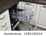 the open dishwasher built into... | Shutterstock . vector #1282130314