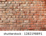 old red brick wall background... | Shutterstock . vector #1282198891