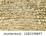 old beige stone granite wall... | Shutterstock . vector #1282198897