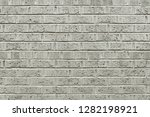 old grey brick wall background... | Shutterstock . vector #1282198921