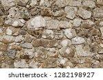 grey granite wall background... | Shutterstock . vector #1282198927