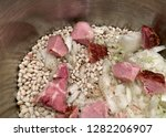 navy beans  onions  and ham in...