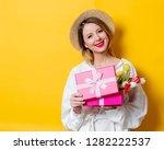 beautiful woman in white shirt... | Shutterstock . vector #1282222537