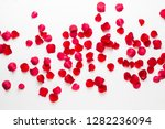Stock photo valentine s day rose flowers petals on white background valentines day background flat lay top 1282236094