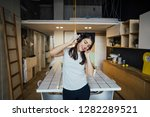 cheerful woman listening to... | Shutterstock . vector #1282289521