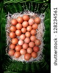 Easter eggs in  natural  green eco wicker basket - stock photo