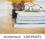 eyes glasses on books on wooden ... | Shutterstock . vector #1282396051