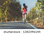 asian woman runners she was... | Shutterstock . vector #1282396144