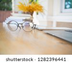 close up eyes glasses on wooden ... | Shutterstock . vector #1282396441