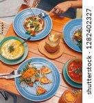 raw vegetarian snacks  pizza   Shutterstock . vector #1282402327