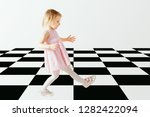 a child walks on the floor | Shutterstock . vector #1282422094