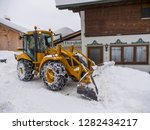 caterpillar with snow chains...   Shutterstock . vector #1282434217