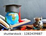 hat graduation model on globe...   Shutterstock . vector #1282439887
