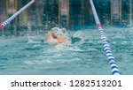 athlete swimming in a pool  | Shutterstock . vector #1282513201