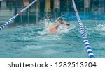 athlete swimming in a pool  | Shutterstock . vector #1282513204