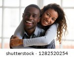 portrait of happy african... | Shutterstock . vector #1282520254