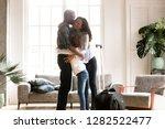 happy black family embrace... | Shutterstock . vector #1282522477