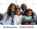 happy black family of four dad... | Shutterstock . vector #1282523554