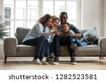 happy african family with 2... | Shutterstock . vector #1282523581