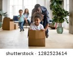 african dad playing with mixed...   Shutterstock . vector #1282523614