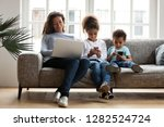 black mom and kids using laptop ... | Shutterstock . vector #1282524724