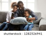 happy african father taking... | Shutterstock . vector #1282526941