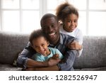 happy african american dad and... | Shutterstock . vector #1282526947