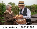 1940s delivery man and elderly... | Shutterstock . vector #1282542787