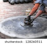 hands of a potter crafting... | Shutterstock . vector #128260511