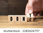 hand flips a cube with letters  ... | Shutterstock . vector #1282626757