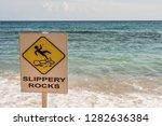 a signpost at the beach.... | Shutterstock . vector #1282636384