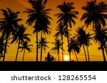 great sunset and coconut tree... | Shutterstock . vector #128265554