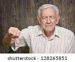 grumpy old man giving thumbs... | Shutterstock . vector #128265851