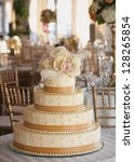 wedding cake with roses at... | Shutterstock . vector #128265854