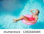 enjoying suntan and vacation.... | Shutterstock . vector #1282660684