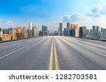 empty asphalt road and city...   Shutterstock . vector #1282703581