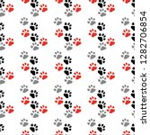 paw print seamless. traces of... | Shutterstock .eps vector #1282706854