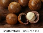 roasted macadamias on wooden... | Shutterstock . vector #1282714111
