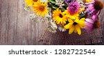 bouquet of wild flowers vintage ...   Shutterstock . vector #1282722544