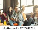 football fans watching a match... | Shutterstock . vector #1282734781