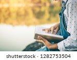 women in winter sit read... | Shutterstock . vector #1282753504