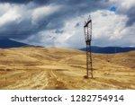 high voltage power line pylon... | Shutterstock . vector #1282754914