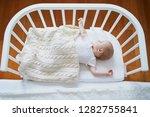 adorable baby girl sleeping in... | Shutterstock . vector #1282755841
