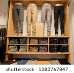 brown pants on the store shelf. ... | Shutterstock . vector #1282767847
