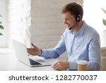 smiling businessman in... | Shutterstock . vector #1282770037