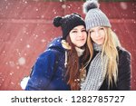 funny and happy two beautiful... | Shutterstock . vector #1282785727