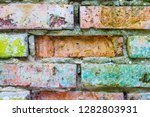 old grunge colored brick wall... | Shutterstock . vector #1282803931