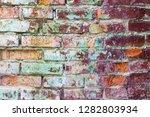 grunge colored brick wall... | Shutterstock . vector #1282803934