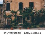 an old french house with...
